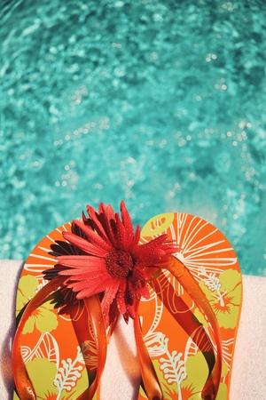 flip flop: Flip Flops on white towel by swimming pool