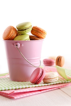 Delicious French Macaroons  in pail on table