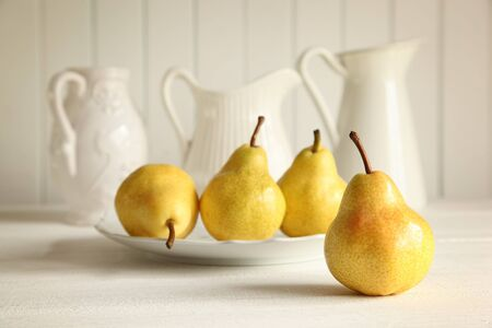 Fresh ripe pears on wooden table photo