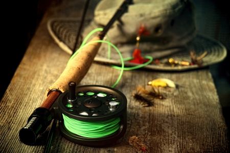 baits: Fly fishing equipment with old hat on bench