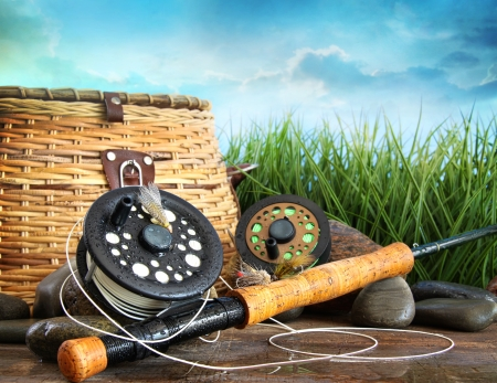 tackle: Closeup of fly fishing equipment and basket