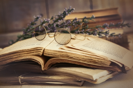 writing on glass: Old books open on a wooden table  Stock Photo