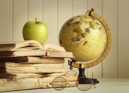 very dirty: Old books with apple and globe