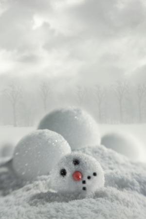 Broken snowman in snowy background photo