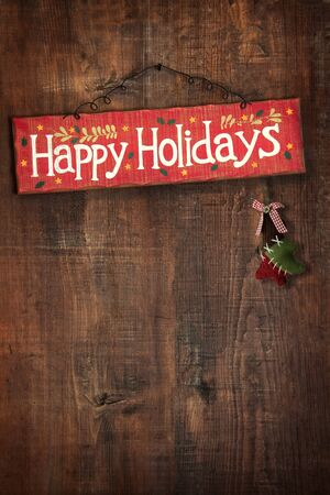 distressed: Bright holiday sign on distressed wooden wall  Stock Photo