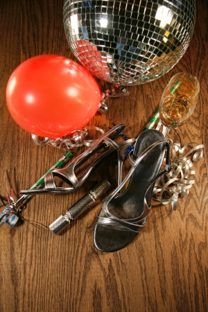 Party shoes on wood floor with champagne glass photo