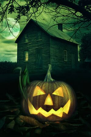 scary pumpkin: Big Halloween pumpkin in front of a Spooky house Stock Photo