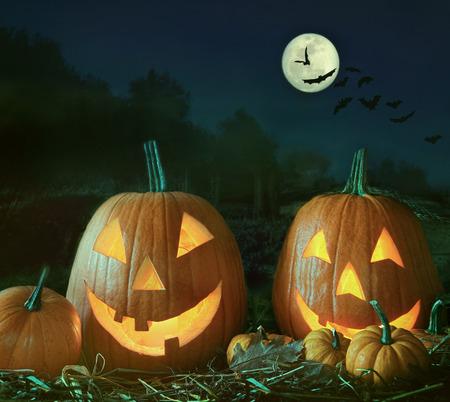 Night scene with Halloween pumpkins and moon