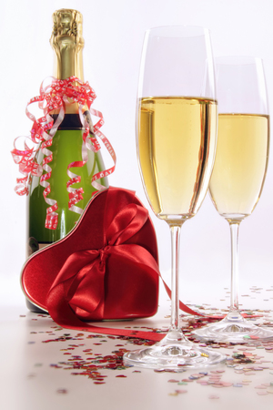 Glasses of champagne for Valentine s day with heart and ribbons photo