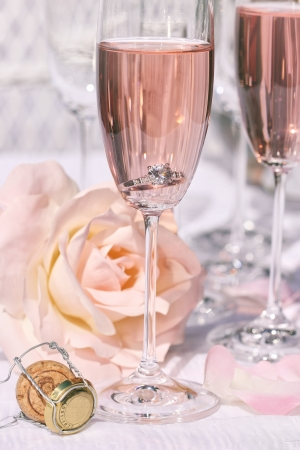 flutes: Ring in pink champagne with flowers Stock Photo