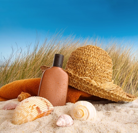 sand dunes: Straw hat with towel at the beach