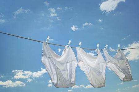 clothesline: Mens underwear hanging on clothesline Stock Photo