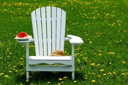 Slice of watermelon on adirondack chair photo
