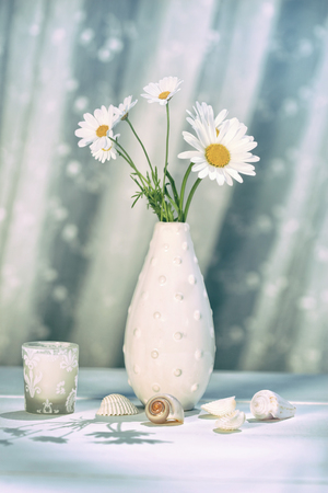 chamomile flower: Summer daisies in vase on table Stock Photo