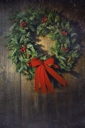 door leaf: Christmas wreath on the wooden background