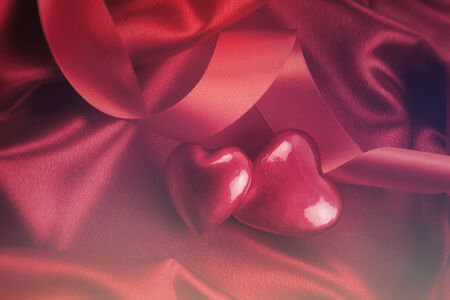 satin background: Red hearts on satin background