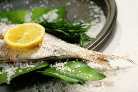alt: Fish tale with lemon, alt and herbs