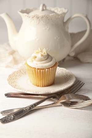 vanilla cupcake: Sweet vanilla cupcake ready to eat Stock Photo
