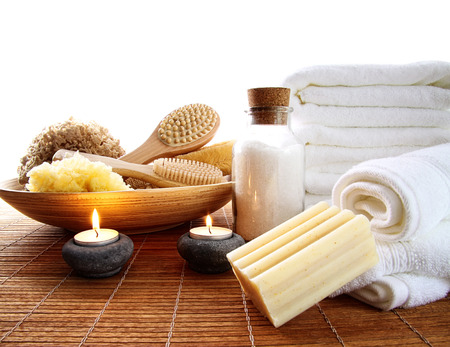 Spa accessories with candles and towels