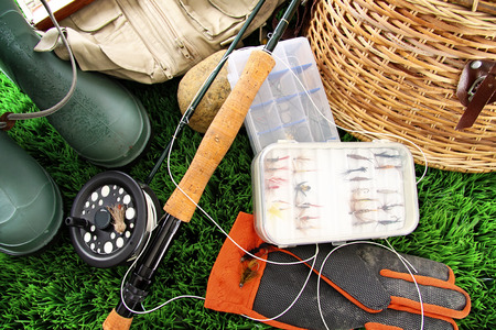 color image fish hook: Fly fishing equipment and boots ready to use