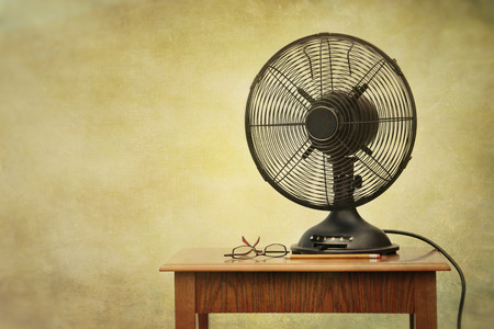 Old electric fan on table with retro look feeling