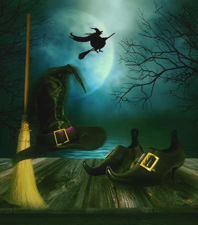fear: Witches broom hat and shoes with spooky Halloween background Stock Photo