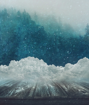 Winter landscape with snow covered wooden table Stock Photo