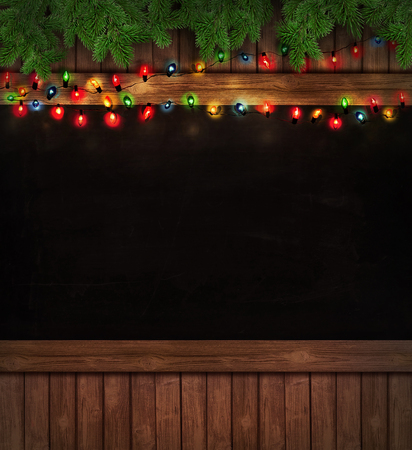 harsh light: Christmas holiday lights on wooden blackboard