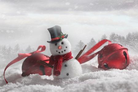 Snowman with bells in snowy winter background Standard-Bild
