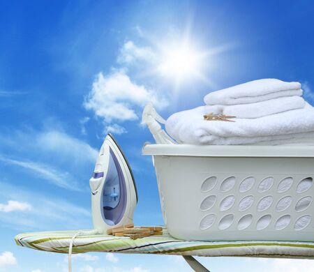 peg board: Iron on ironing board with laundry basket