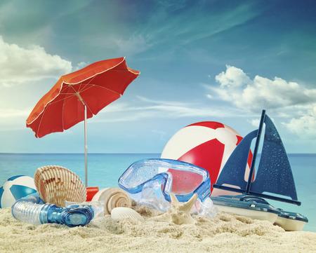 beach toys: Beach toys on sandy beach with blue sea in background