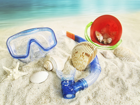 beachwear: Water goggles and beach toys in the sand
