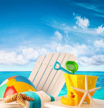 Beach toys on summer chair by the ocean