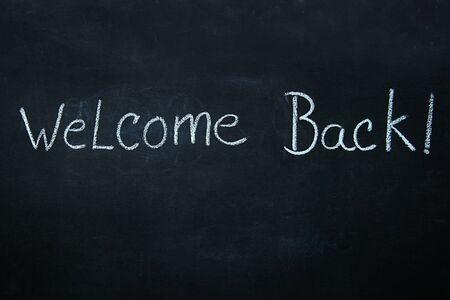 Words written in white chalk on blackboard 免版税图像