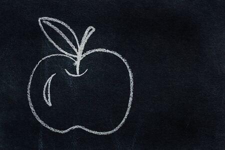 Symbol written in white chalk on blackboard