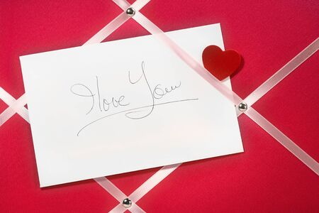 I love you message card handwriting on pinup board 免版税图像