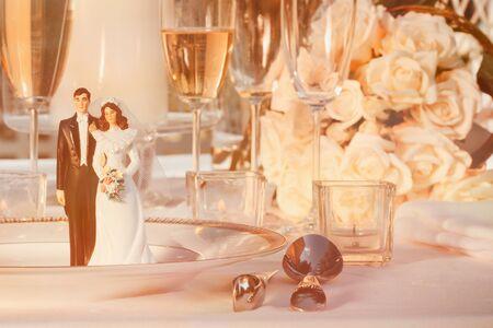 Wedding cake figurines on plate