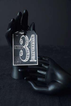 Black hands holding a Halloween card 免版税图像