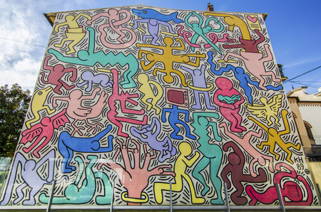 Italy,pisa - Tuttomondo, Murales di Keith Haring made in 1989 on the outer wall of the rectory of the church of St. Anthony Abbot in Pisa 報道画像