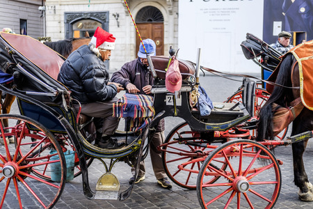 coachman: Italy, Rome, Piazza di Spagna, 13122015, Coachman play cards waiting for customers