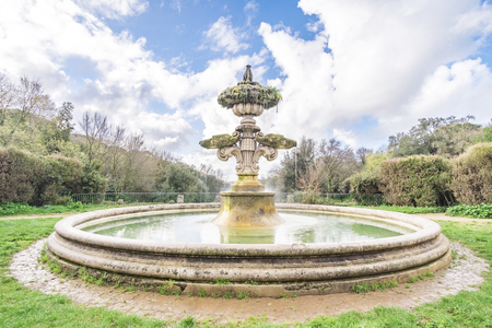 Italy, Rome, Villa Dora Pamphili - 06 March 2016: I found this beautiful and antique fountain in the park, the view is spectacular and the sound transmits tranquility