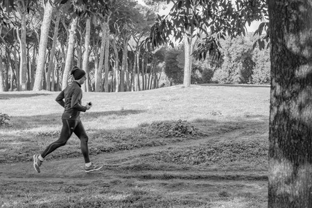 regina: Italy, Rome, Villa Dora Pamphili - 06 March 2016: There walkers and runners in the park of Villa Doria Pamphili, here are some shots in black white