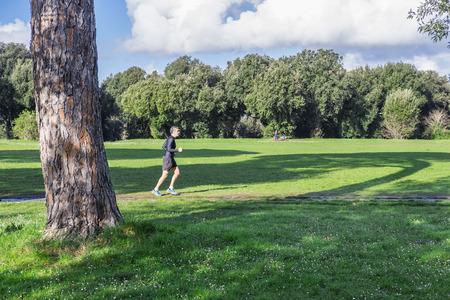 dora: Italy, Rome, Villa Dora Pamphili - 06 March 2016: There walkers and runners in the park of Villa Doria Pamphili