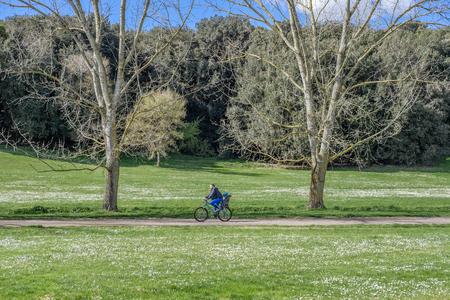 dora: Italy, Rome, Villa Dora Pamphili - 06 March 2016: This huge park of Rome is one of the best places for cyclists where they can walk in the middle of nature and escape from the city