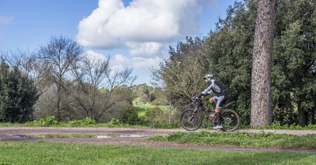 regina: Italy, Rome, Villa Dora Pamphili - 06 March 2016: This huge park of Rome is one of the best places for cyclists where they can walk in the middle of nature and escape from the city