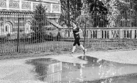 pino: Italy, Rome, Villa Dora Pamphili - 06 March 2016: There walkers and runners in the park of Villa Doria Pamphili, here are some shots in black white