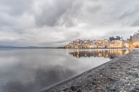 very cold: Italy, Bracciano, Anguillara Sabazia - 31 January 2016: It is a very cloudy morning but not very cold. This is the classic winter day on Bracciano Lake and Anguillara still sleeps in the background