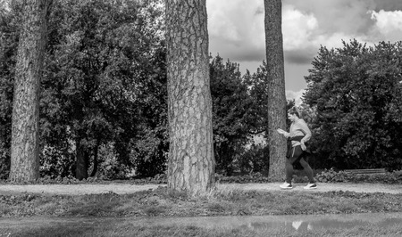 dora: Italy, Rome, Villa Dora Pamphili - 06 March 2016: There walkers and runners in the park of Villa Doria Pamphili, here are some shots in black white