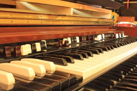 soft pedal: Black, white and brown keys of old organ
