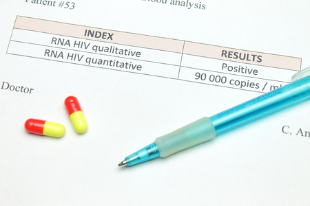 infective: Pills and a positive HIV test Stock Photo